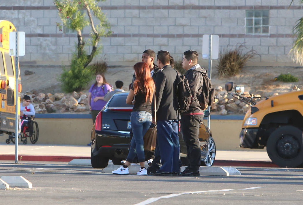 Students wait outside Cheyenne High School as North Las Vegas police investigate a burglary at their school at 3200 W. Alexander Road, early Wednesday, April 19, 2017. Bizuayehu Tesfaye Las Vegas  ...