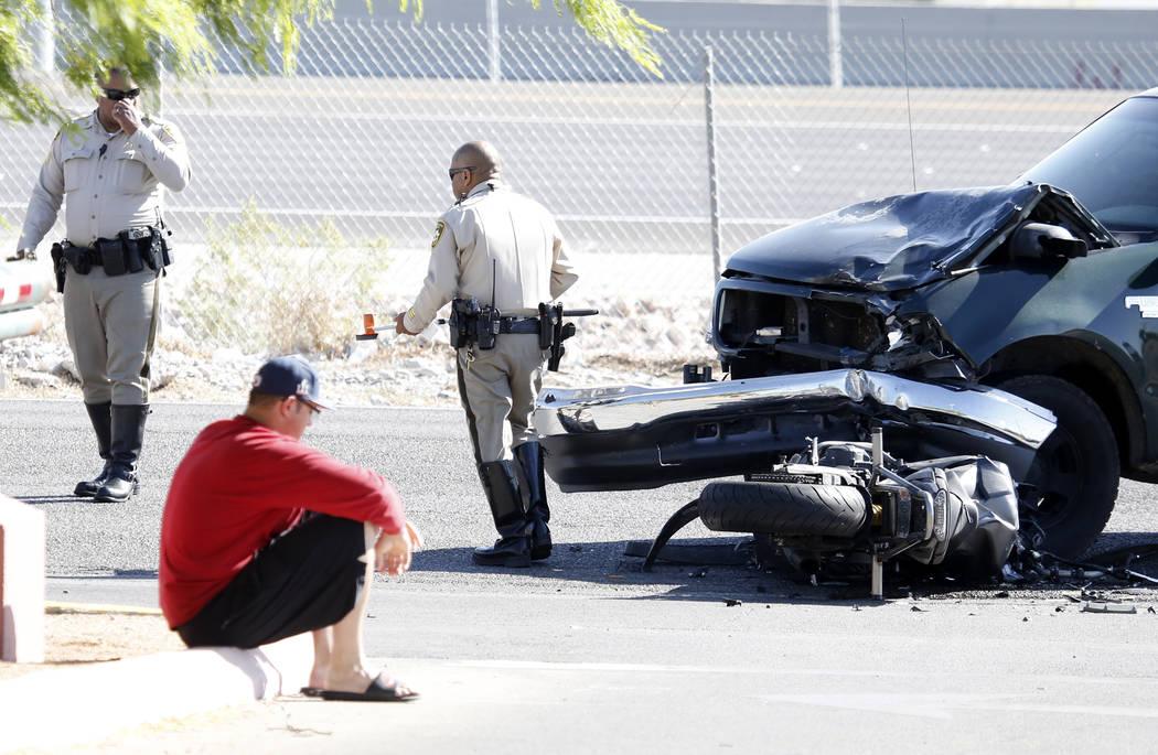 Metro police investigate a crash between a motorcycle and a pickup truck near Oso Blanca and Elkhorn roads in northwest Las Vegas, Wednesday morning, April 19, 2017 Bizuayehu Tesfaye Las Vegas Rev ...