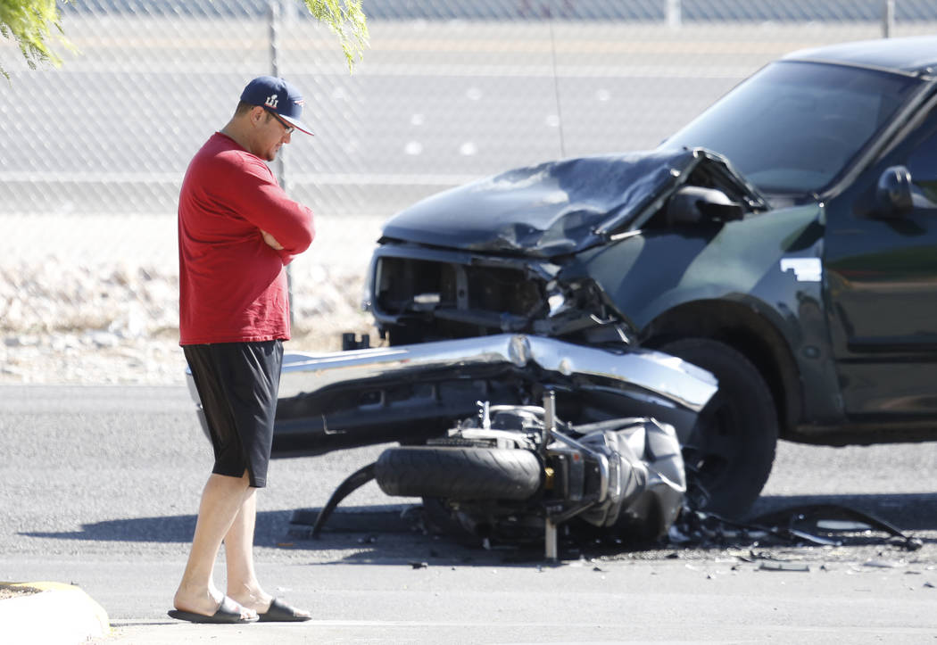 The driver of a pickup truck that collided with a motorcycle at the crash site where Metro police investigate near Oso Blanca and Elkhorn roads in northwest Las Vegas, Wednesday morning, April 19, ...