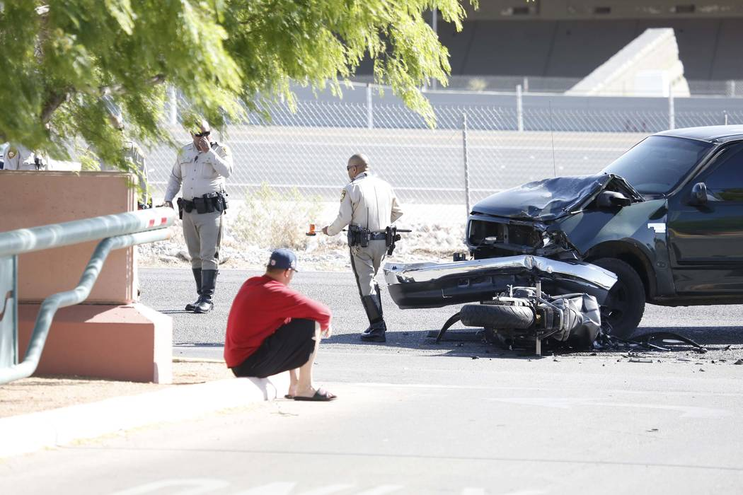 Metro police investigate a crash between a motorcycle and a pickup truck near Oso Blanca and Elkhorn roads in northwest Las Vegas, Wednesday morning, April 19, 2017. Bizuayehu Tesfaye Las Vegas Re ...