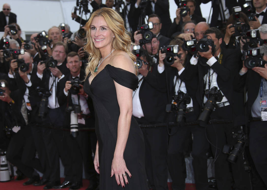 Actress Julia Roberts poses for photographers upon arrival for the screening of the film Money Monster at the 69th international film festival, Cannes, southern France on Thursday, May 12, 2016. J ...
