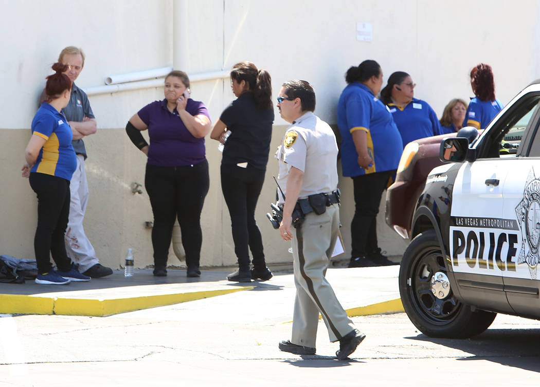 ARCO gas station employees outside the store where Las Vegas police investigate the scene of a stabbing at at the corner of East Bonanza Road and Lamb Boulevard on Wednesday, April 19, 2017, in La ...