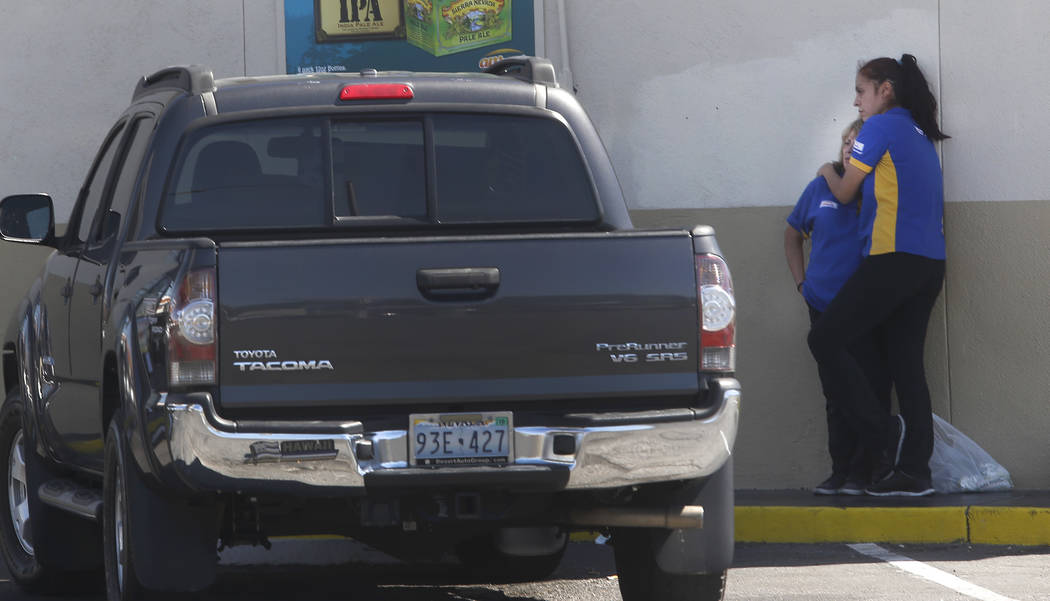 Arco gas station employees reacts to a crime scene where a stabbing occurred at the Arco gas station located on Bonanza Rd. and N Lamb Blvd. on Wednesday, April 19, 2017, in Henderson. One person  ...