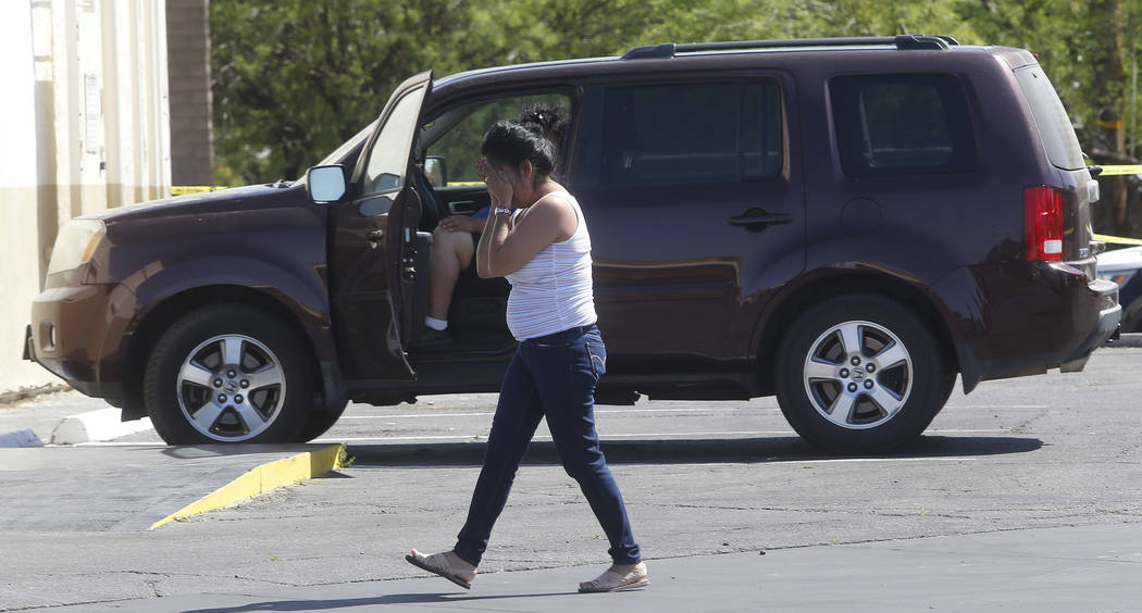A lady reacts after arriving to a crime scene where a stabbing occurred at the Arco gas station located on Bonanza Rd. and N Lamb Blvd. on Wednesday, April 19, 2017, in Henderson. One person has d ...