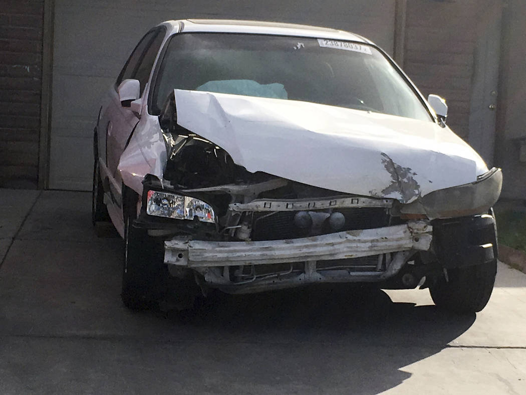 A 2002 Honda Accord involved in a March 3, 2017, crash in which an exploding Takata air bag inflator badly injured the driver, Karina Dorado, sits in a driveway in Las Vegas on Tuesday, April 18,  ...