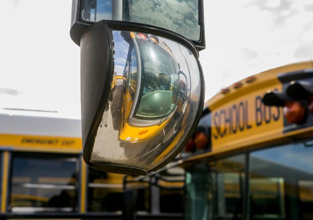 A Clark County School District bus is reflected off a mirror in the Northwest Bus Yard, CCSD, 10901 West Washburn Road on Monday, Jan. 23, 2017. (Jeff Scheid/Las Vegas Review-Journal) @jeffscheid
