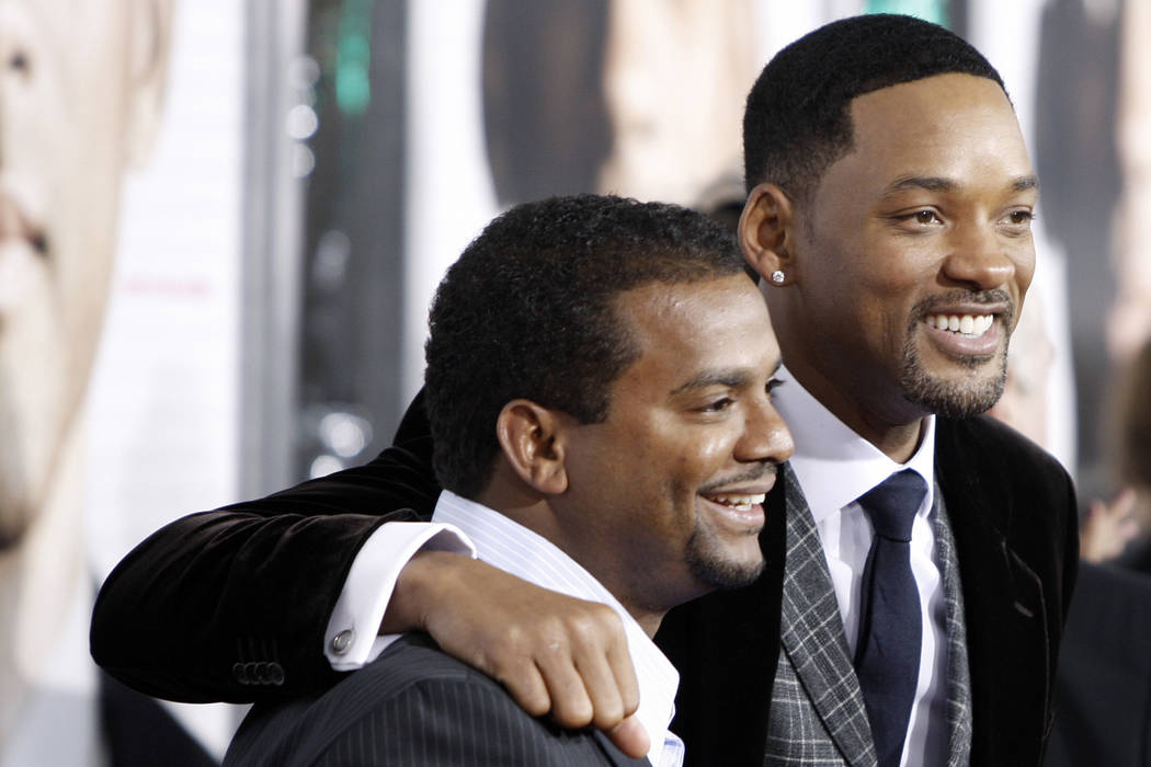 """Will Smith, right, and Alfonso Ribeiro pose together at the premiere of """"Seven Pounds"""" in Los Angeles on Dec. 16, 2008. Matt Sayles/AP"""