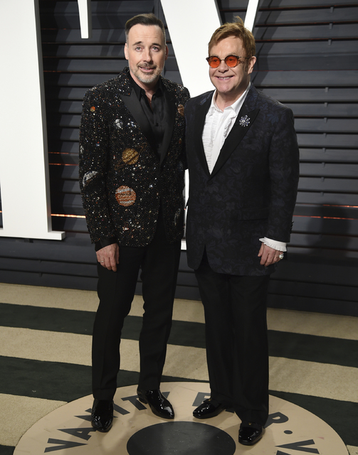 David Furnish, left, and Elton John arrive at the Vanity Fair Oscar Party on Monday, Feb. 27, 2017, in Beverly Hills, Calif. (Photo by Evan Agostini/Invision/AP)