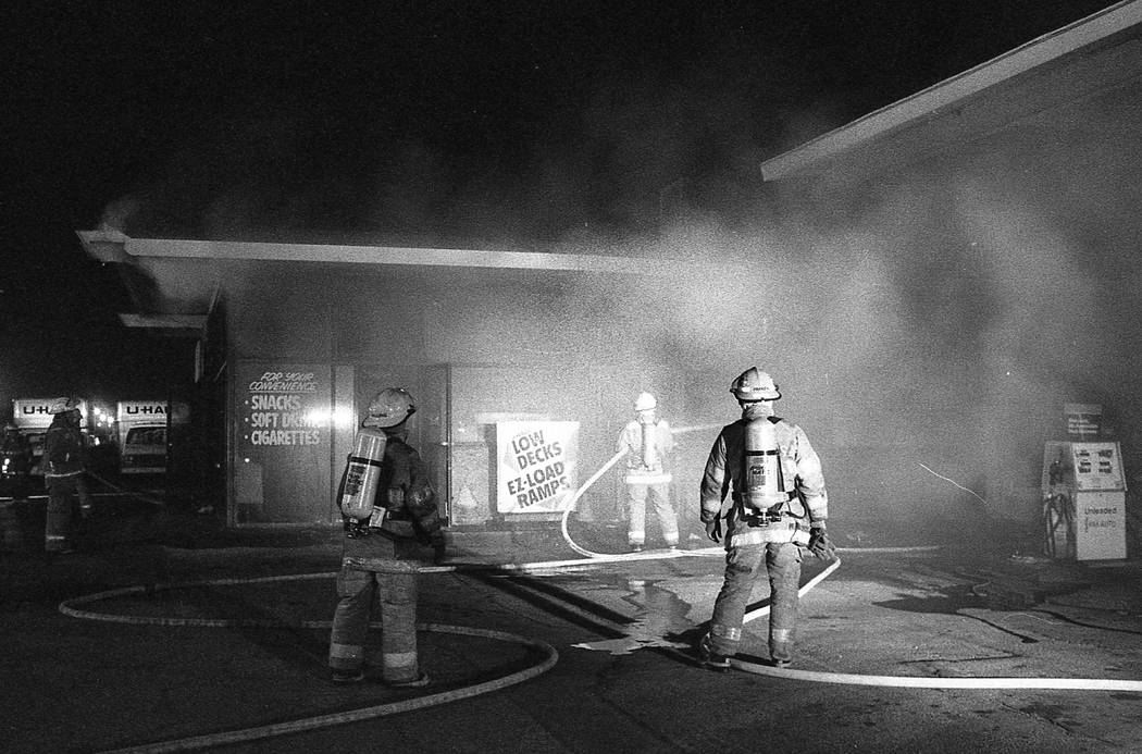 Las Vegas firefighters tend to a blaze at a gas station located south of west Las Vegas near Alta Drive at Martin Luther King Boulevard on April 30, 1992 in Las Vegas.  Las Vegas Review-Journal Fi ...