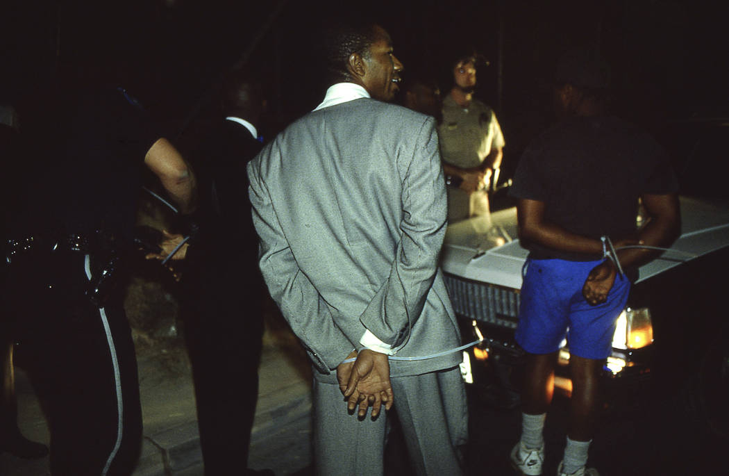 Unidentified men are detained near Lake Mead Boulevard and D Street on April 30, 1992 in North Las Vegas. Officers arrested about 10 men at the intersection which was littered with broken glass an ...