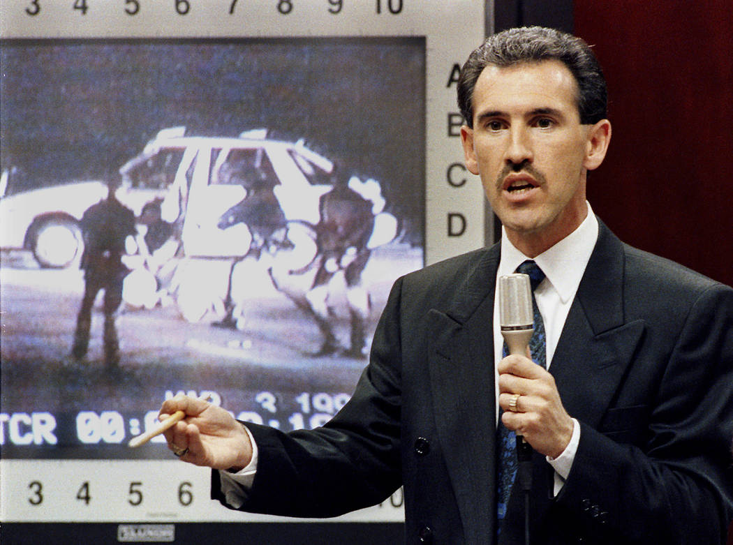 Los Angeles police officer Theodore Briseno defends his actions in the assault on motorist Rodney King during court testimony in Simi Valley, Calif., April 3, 1992. A scene from the video of the a ...