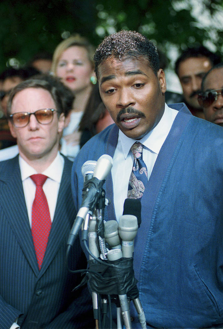 Rodney King, right, makes his first statement, pleading for an end to the rioting in South Central Los Angeles, May 1, 1992, in Los Angeles. At left is King's attorney Steven Lerman. On April 29,  ...