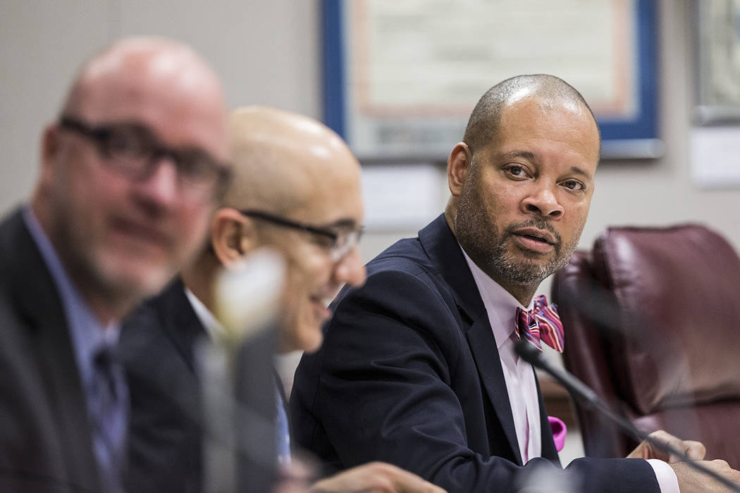 Senate Majority Leader Aaron Ford listens to Sen. Tick Segerblom, D-Nev., during the second day of the Nevada Legislative session on Tuesday, Feb. 7, 2017, at the Legislative Building, in Carson C ...