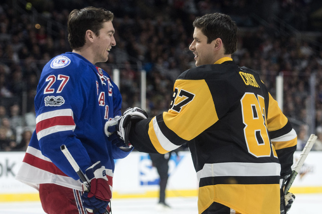 New York Rangers' Ryan McDonagh and Pittsburgh Penguins' Sidney Crosby smile during the NHL All-Star Skills Competition on Saturday, Jan. 28, 2017, in Los Angeles. (Kyusung Gong/The Orange County  ...