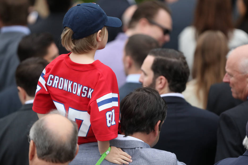 A youth wears a jersey of New England Patriots tightend Rob Gronkowski as President Donald Trump hosted a ceremony on the South Lawn of the White House in Washington, Wednesday, April 19, 2017, to ...