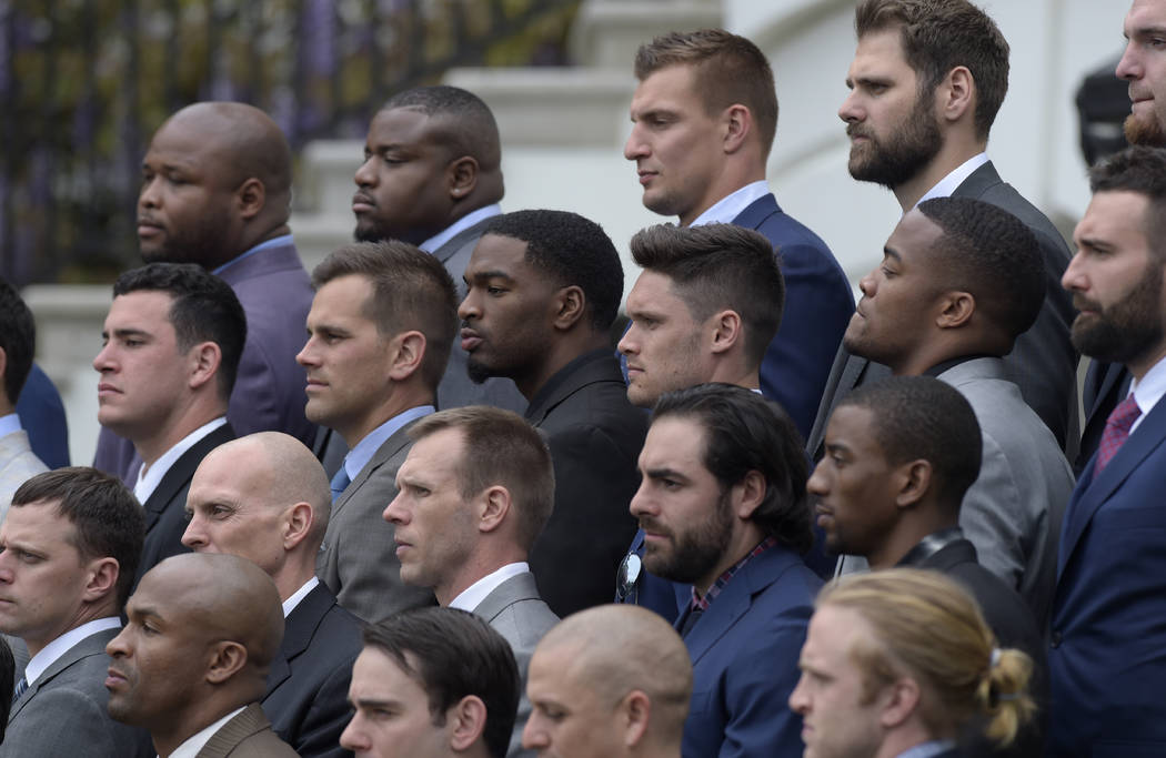Members of the New England Patriots, including tightend Robert Gronkowski, top center right, listen as President Donald Trump speaks during a ceremony on the South Lawn of the White House in Washi ...