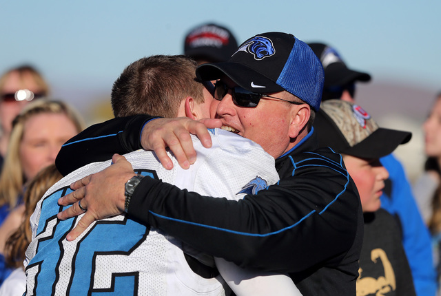Pahranagat Valley Head Coach Ken Higbee and his son Christian celebrate after defeating Whittell 54-28 in the NIAA DIV championship game at Dayton High School in Dayton, Nev., on Sunday, Nov. 21,  ...