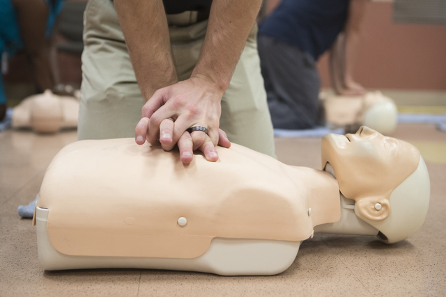 EMS physician Travis Marshall demonstrates on how to give proper CPR at the East Las Vegas Community Center Oct. 13, 2016. (Loren Townsley/View) Follow @lorentownsley
