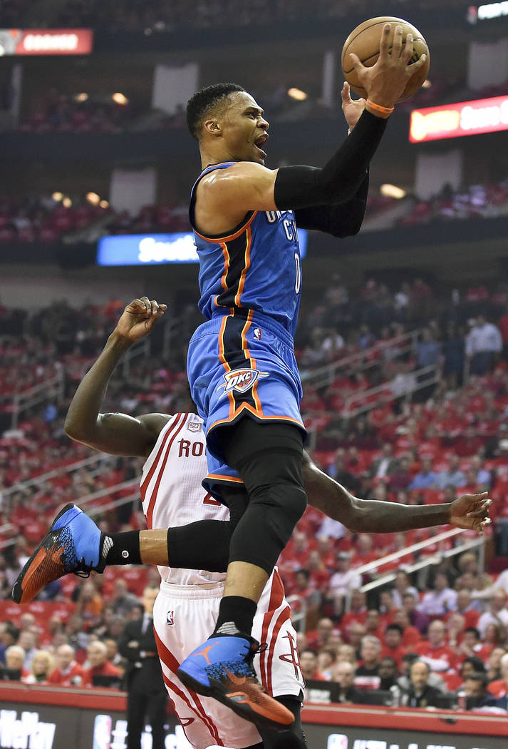 Oklahoma City Thunder guard Russell Westbrook drives past Houston Rockets guard Patrick Beverley during the first half in Game 2 of an NBA basketball first-round playoff series, Wednesday, April 1 ...