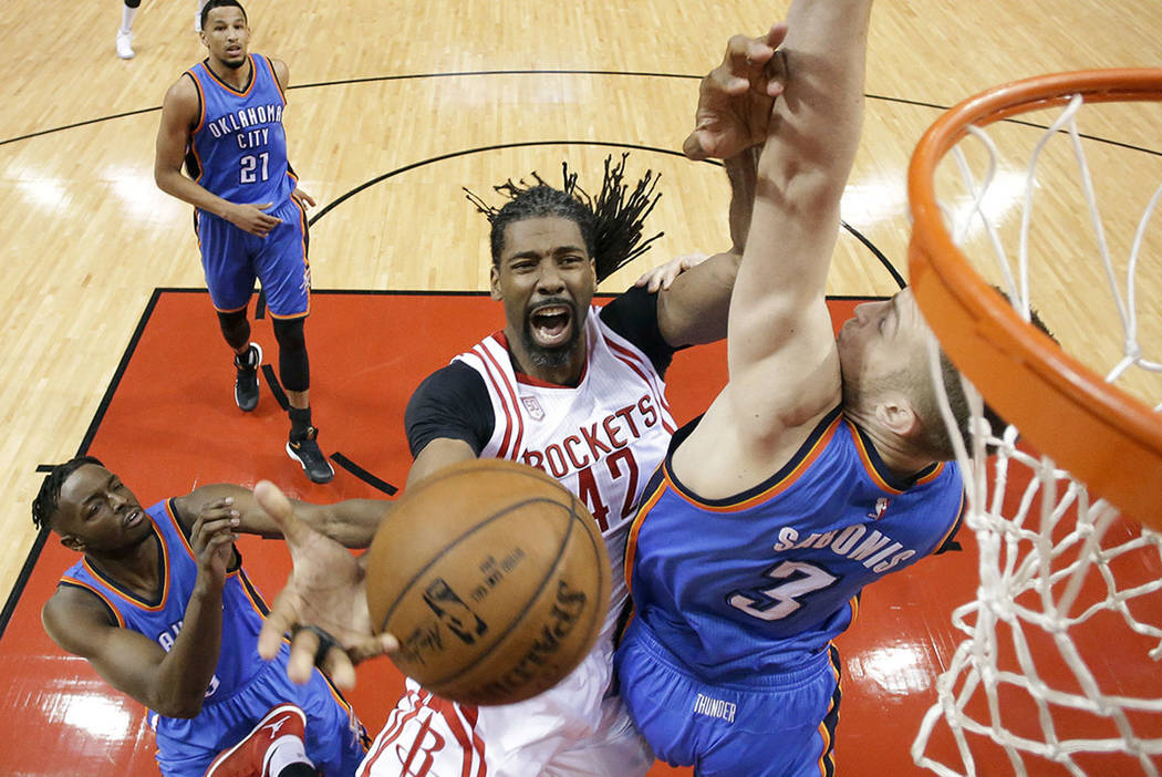 Houston Rockets center Nene Hilario (42) is fouled by Oklahoma City Thunder forward Domantas Sabonis (3) during the first half in Game 2 of an NBA basketball first-round playoff series, Wednesday, ...