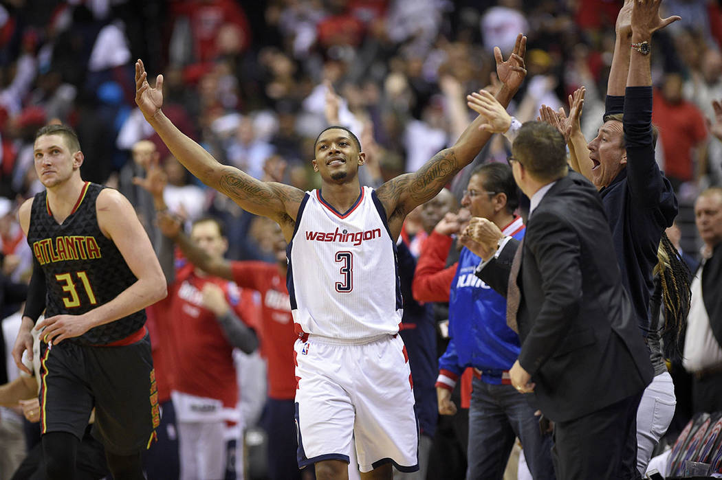 Washington Wizards guard Bradley Beal (3) reacts after he made a 3-point basket during the second half in Game 2 of a first-round NBA basketball playoff series, as Atlanta Hawks forward Mike Musca ...