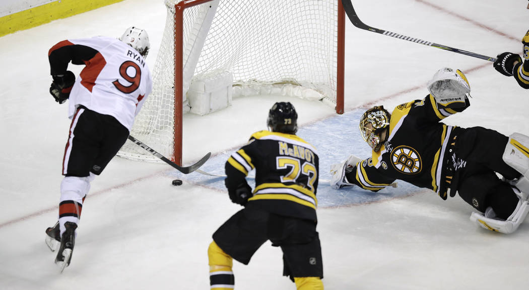 Ottawa Senators right wing Bobby Ryan (9) shoots as Boston Bruins goalie Tuukka Rask tries to make a save on a goal during the third period of Game 4 of a first-round NHL hockey playoff series in  ...