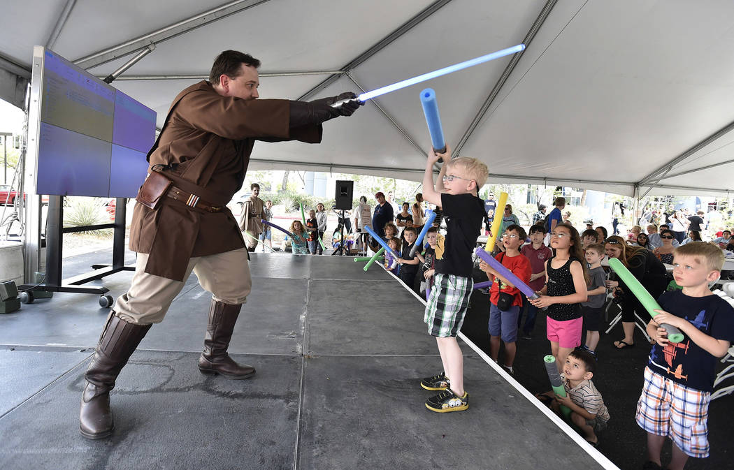 M. Gabriel Colbaugh of Nar Shaddaa Temple Saber Guild demonstrates proper lightsaber technique  May 4, 2016 during the inaugural May Science be with You event  the Desert Research Institute and At ...