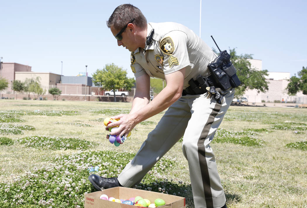 Metro police officer Dave Watts hides eggs during the annual Easter egg hunt event at Doolittle Community Field on Tuesday, April 10, 2017, in Las Vegas. Bizuayehu Tesfaye Las Vegas Review-Journal ...