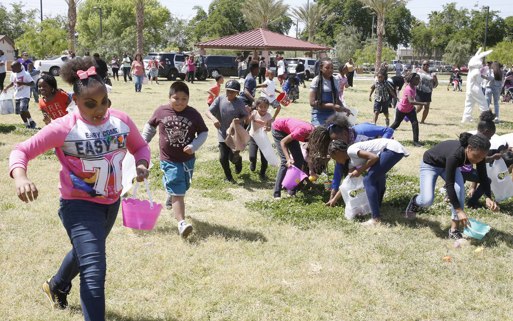 Children, including Tiphanie Bates, left, participate in the annual Easter egg hunt event at Doolittle Community Field on Tuesday, April 10, 2017, in Las Vegas. (Bizuayehu Tesfaye/Las Vegas Review ...