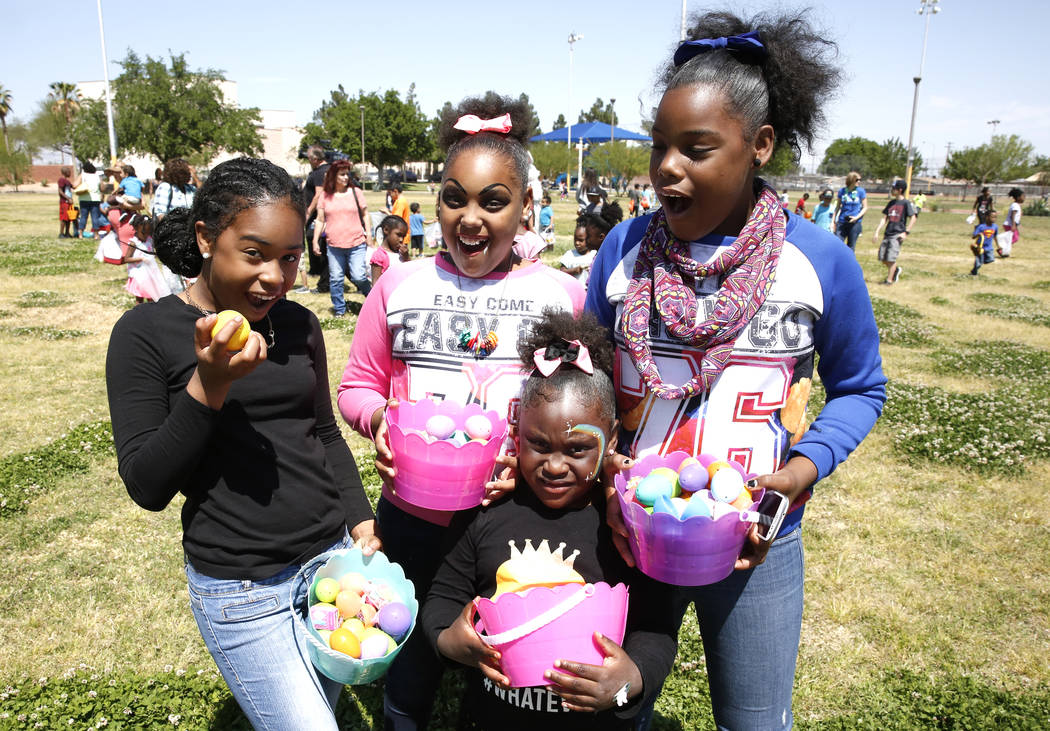 Lakayia Lock, left, Tiphanie Bates, Daimecia Bates, right, and J'la Ward, 5, show off their eggs after participating in the annual Easter egg hunt event at Doolittle Community Field on Tuesday, Ap ...