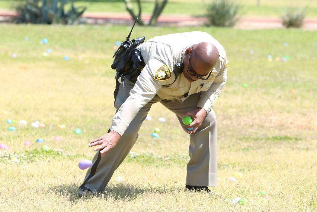 Metro police officer Charles Jenkins hides eggs during the annual Easter egg hunt event at Doolittle Community Field on Tuesday, April 10, 2017, in Las Vegas. Bizuayehu Tesfaye Las Vegas Review-Jo ...