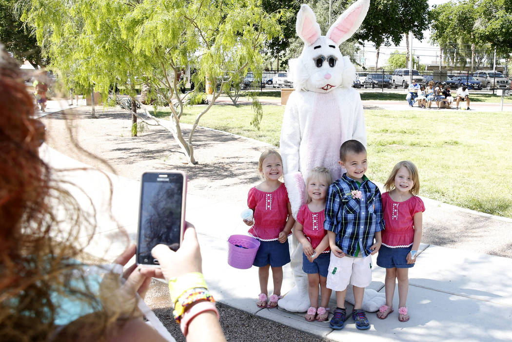 Mykenna Crull, left, 4, Kynslee Cox, 3, Kaydin Rodriguez, 6, and  Bailie Thompson, 3, right, at the annual Easter egg hunt event at Doolittle Community Field on Tuesday, April 10, 2017, in Las Veg ...