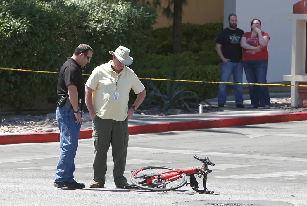 Las Vegas police investigate a fatal crash that left a bicyclist dead in the western Las Vegas Valley, near Red Rock Resort, on Tuesday, April 18, 2017, in Las Vegas. (Bizuayehu Tesfaye/Las Vegas  ...