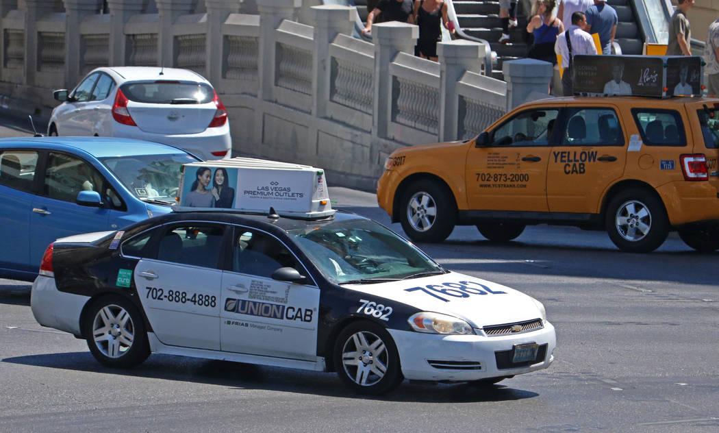 Cab drivers turning onto East Flamingo from South Las Vegas Boulevard near Caesars Palace hotel-casino, Thursday, April 20, 2017. Gabriella Benavidez Las Vegas Review-Journal @gabbydeebee