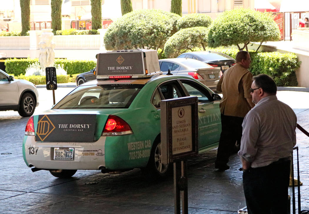 A valet worker at Caesars Palace hotel-casino sends a taxi off with its passengers, Thursday, April 20, 2017. Gabriella Benavidez Las Vegas Review-Journal @gabbydeebee