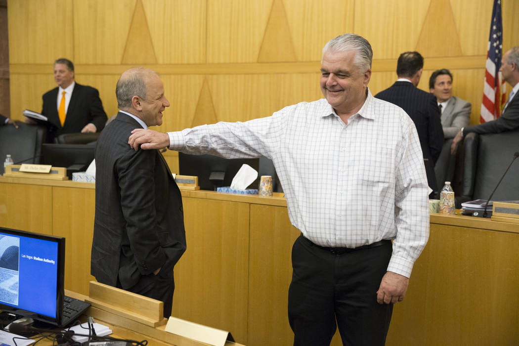 Oakland Raiders President Marc Badain, left, with Clark County Commissioner Steve Sisolak following a Las Vegas Stadium Authority board meeting at the Clark County Government Center on Thursday, A ...