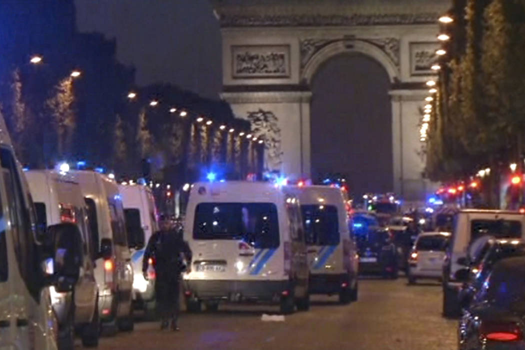 In this image made from video, police attend the scene after an incident on the Champs-Elysees in Paris, Thursday April 20, 2017. French media are reporting that two police officers were shot Thur ...