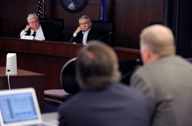 Committee on Local Government Finance chairman Marvin Leavitt, left and member Mark Vincent listen to a presentation given by North Las Vegas acting finance director Darren Adair, right, at the Gr ...