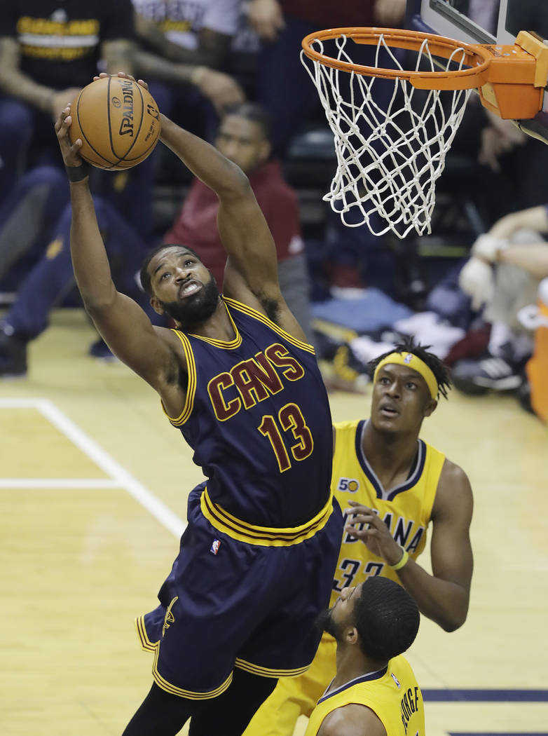 Cleveland Cavaliers' Tristan Thompson grabs a rebound above Indiana Pacers' Myles Turner, rear, during the first half in Game 3 of a first-round NBA basketball playoff series, Thursday, April 20,  ...