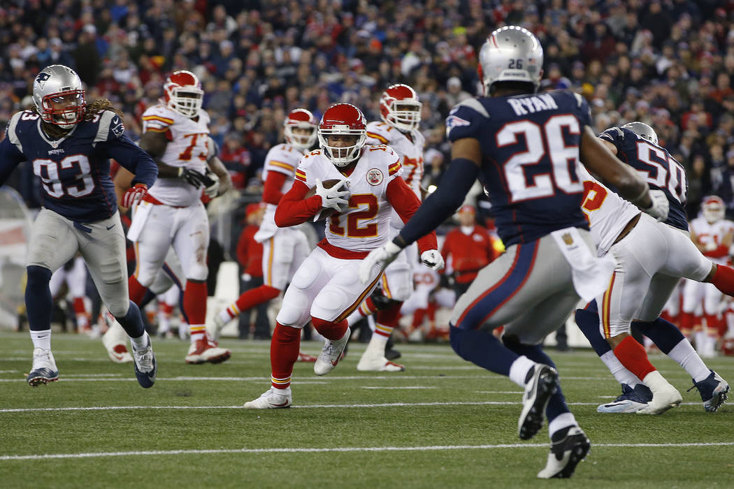 Jan 16, 2016; Foxborough, MA, USA; Kansas City Chiefs wide receiver Albert Wilson (12) carries the ball between New England Patriots defensive end Jabaal Sheard (93) and cornerback Logan Ryan (26) ...