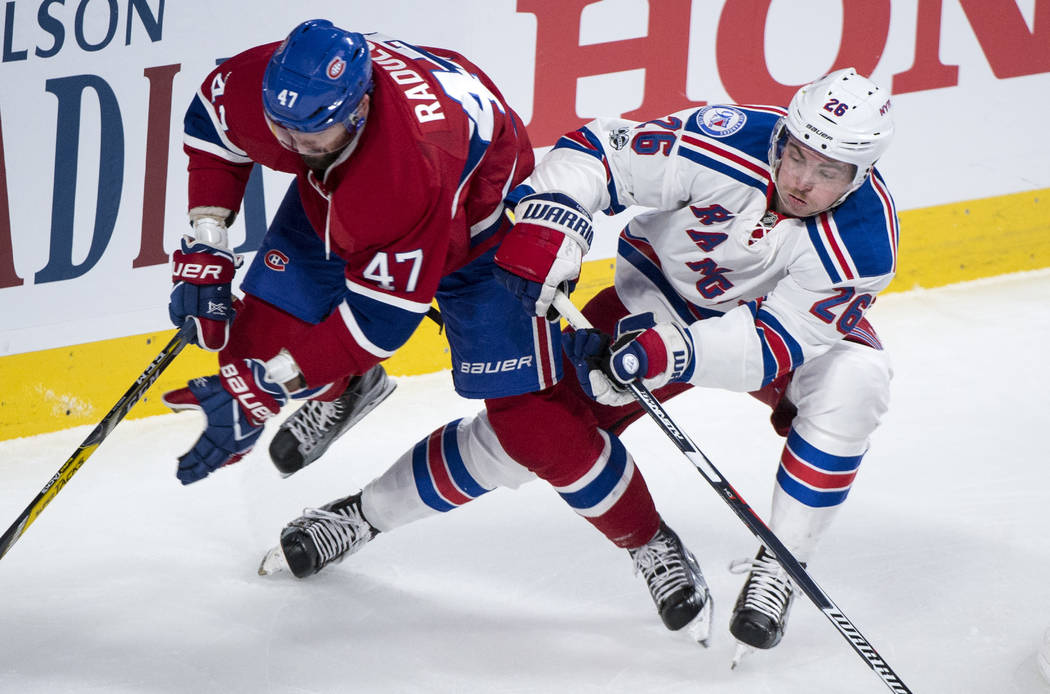Montreal Canadiens right wing Alexander Radulov (47) and New York Rangers left wing Jimmy Vesey (26) vie for control for the puck during the second period of Game 5 of a first-round NHL hockey Sta ...