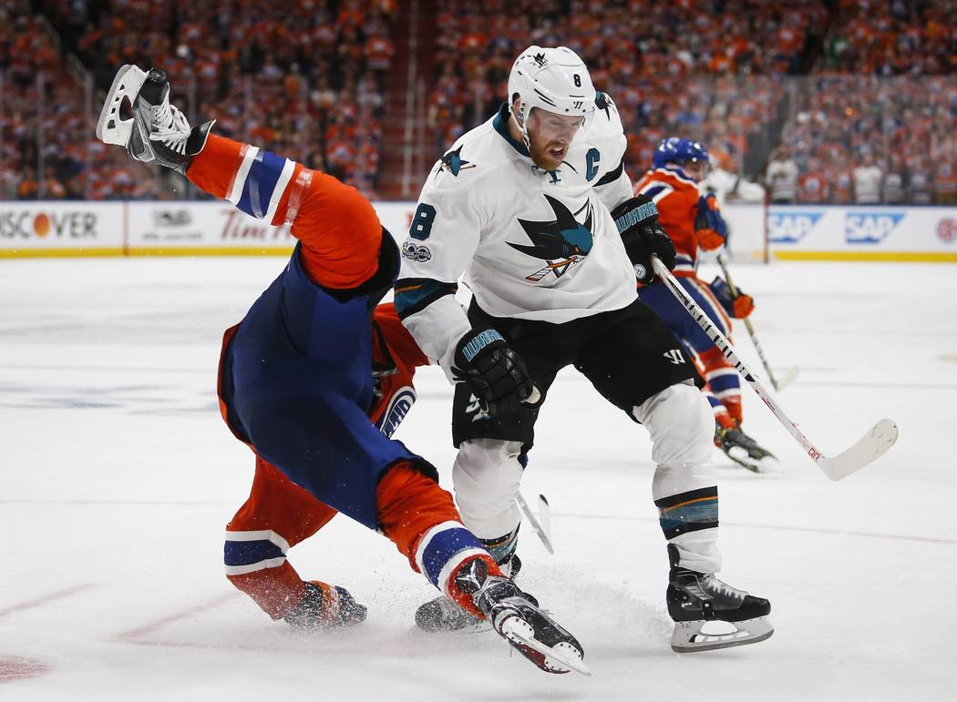 San Jose Sharks' Joe Pavelski, right, upends Edmonton Oilers' Milan Lucic during the third period of Game 5 of a first-round NHL hockey Stanley Cup playoff series, Thursday, April 20, 2017, in Edm ...