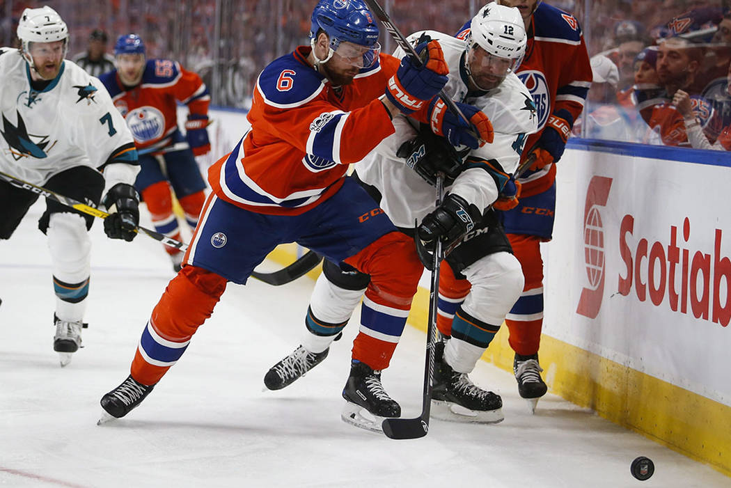 San Jose Sharks' Patrick Marleau, center, tries to get past Edmonton Oilers' Kris Russell, left, and Zack Kassian during the third period of Game 5 of a first-round NHL hockey Stanley Cup playoff  ...