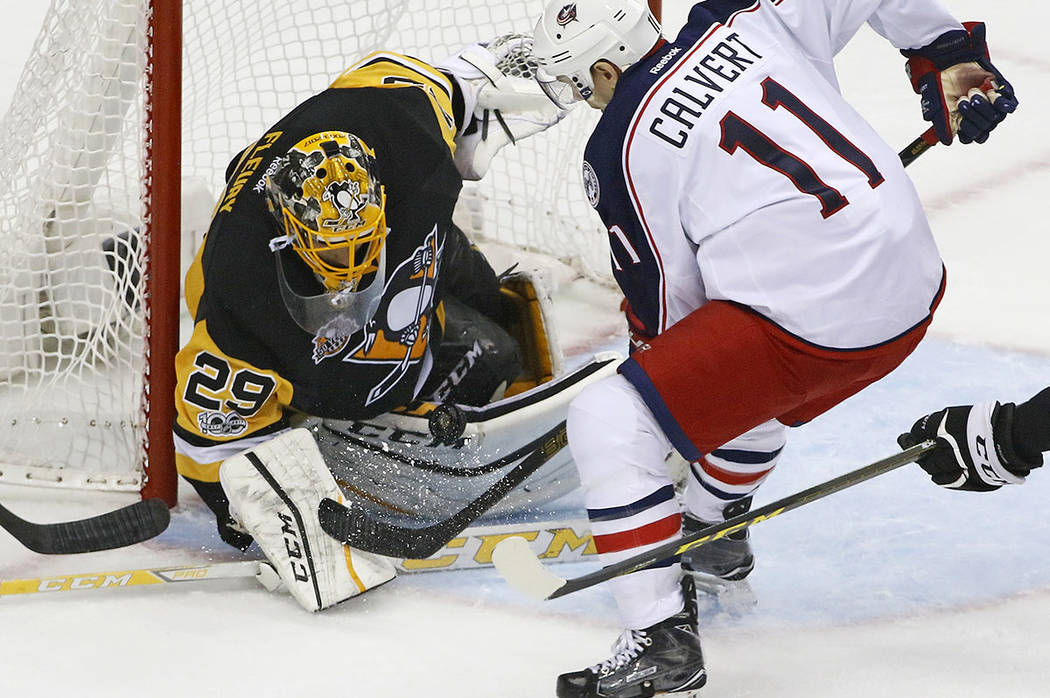 Pittsburgh Penguins goalie Marc-Andre-Fleury (29) stops a shot by Columbus Blue Jackets Matt Calvert (11) during the first period in Game 5 of an NHL first-round hockey playoff series in Pittsburg ...