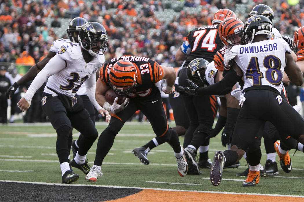 Cincinnati Bengals running back Rex Burkhead (33) scores a touchdown during the second half of the team's NFL football game against the Baltimore Ravens, Sunday, Jan. 1, 2017, in Cincinnati. (AP P ...