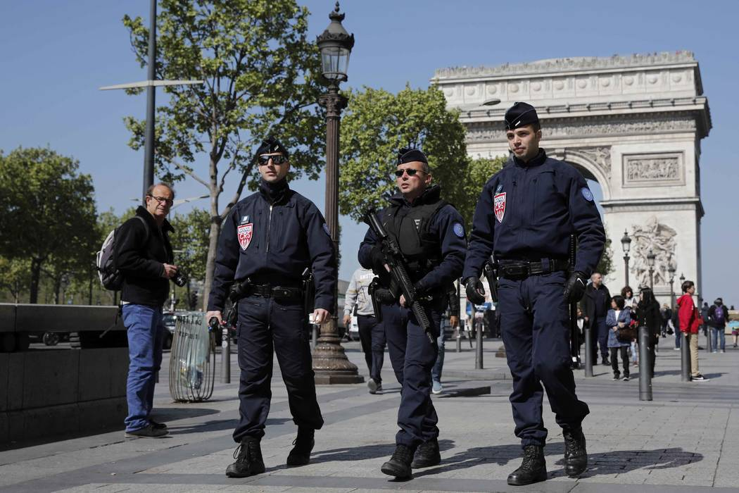French CRS police patrol the Champs-Elysees the day after a policeman was killed and two others were wounded in a shooting incident in Paris, April 21, 2017. Benoit Tessier Reuters