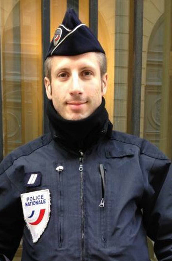 This undated image provided on Friday, April 21, 2017, by FLAG, an association of LGBT police officers, shows French police officer Xavier Jugele. The policeman killed on Paris' most famous boulev ...
