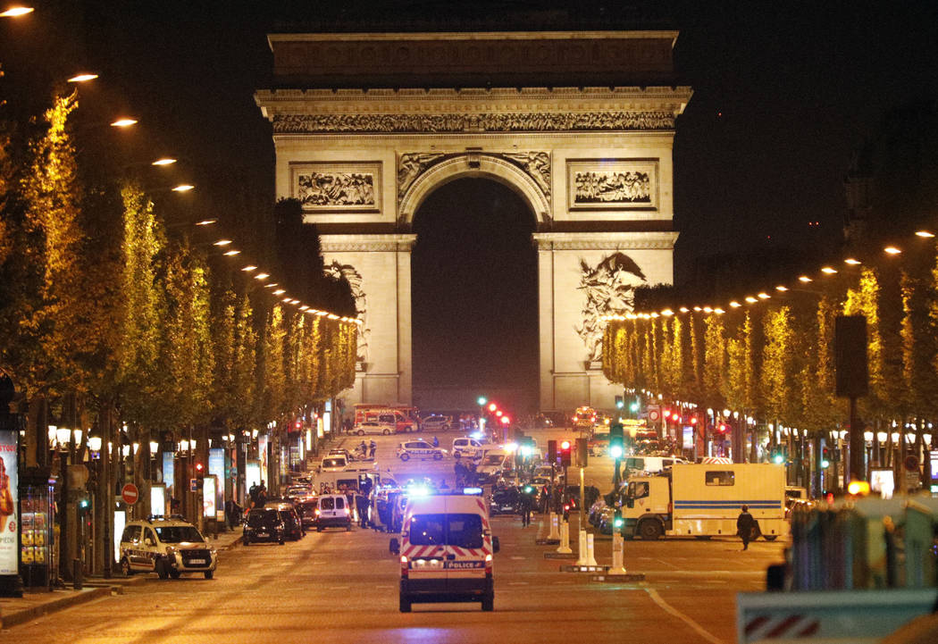 Police forces take positions on the Champs Elysees avenue in Paris, France, after a fatal shooting in which a police officer was killed along with an attacker, Thursday, April 20, 2017. An attacke ...