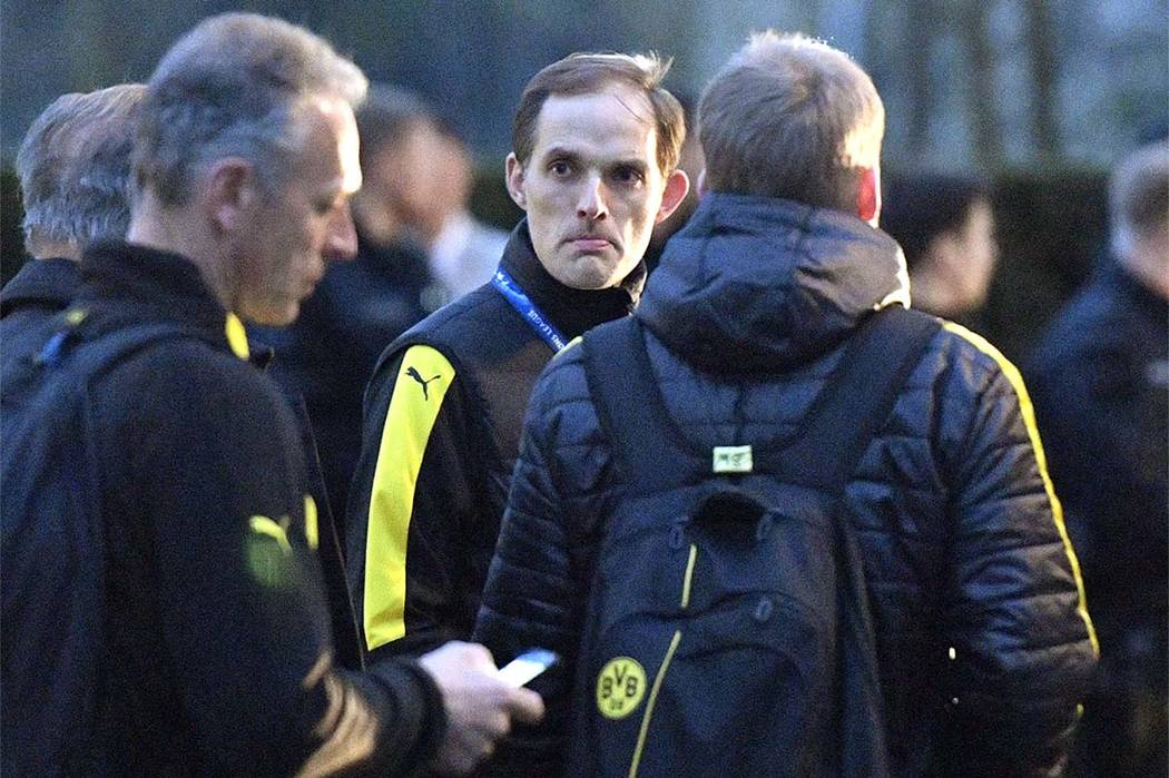 In this April 11, 2017 file photo Dortmund head coach Thomas Tuchel stands outside the team bus after it was damaged in an explosion before the Champions League quarterfinal soccer match between B ...
