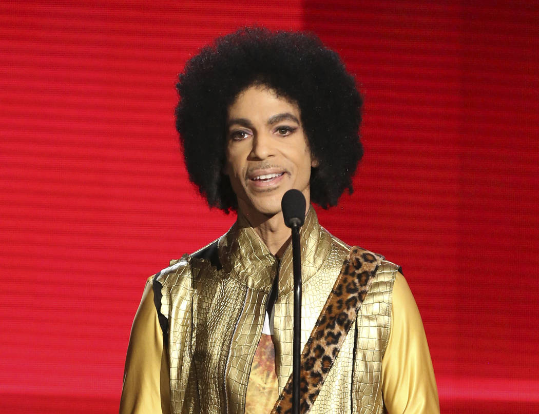 Prince presents the award for favorite album - soul/R&B at the American Music Awards in Los Angeles on Nov. 22, 2015.  Matt Sayles/Invision/AP